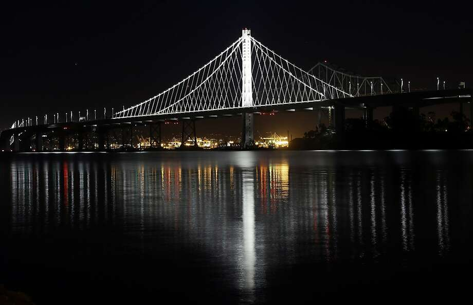 The new eastern span of the San Francisco Oakland Bay Bridge is reflected on the water in a view from Treasure Island on Thursday, Dec. 26, 2013, in San Francisco. (AP Photo/Marcio Jose Sanchez) Photo: Marcio Jose Sanchez, Associated Press
