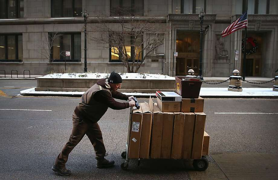 CHICAGO, IL - DECEMBER 26:  A UPS worker delivers packages on December 26, 2013 in Chicago, Illinois. Bad weather and a higher than expected demand from online sales caused FedEx and UPS to miss many Christmas delivery deadlines.  (Photo by Scott Olson/Getty Images) Photo: Scott Olson, Getty Images