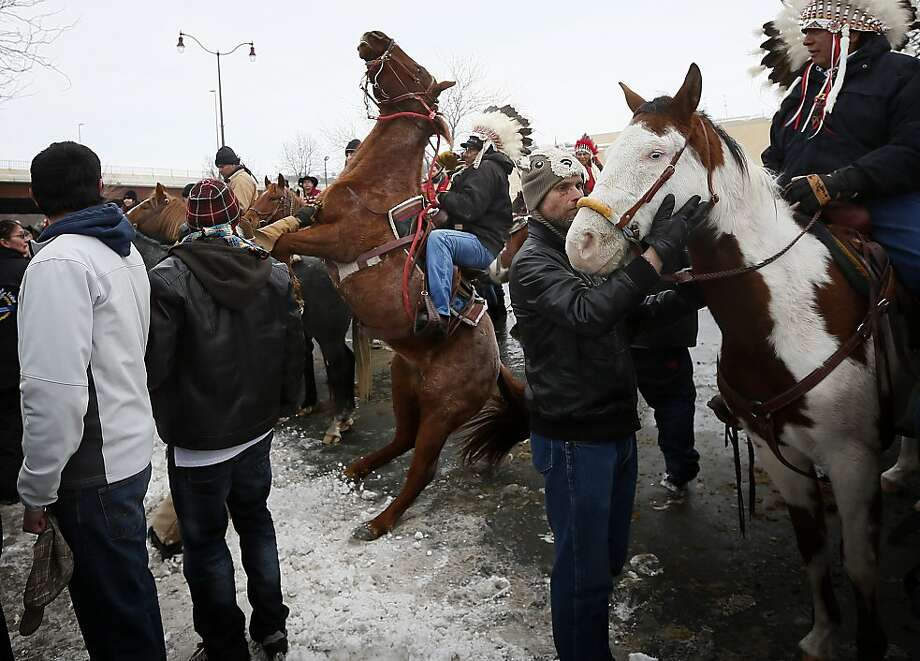 Leland Spotted Bird, of Fort Peck Indian Reservation in Montana, tries to control his horse, spooked from gunfire, during the Dakota Wokiksuye Memorial Ride on Thursday Dec. 26, 2013 at Reconciliation Park in Mankato , Minn. This month, dozens of American Indians, along with other supporters and friends, have ridden 330 miles across South Dakota and into Minnesota to commemorate the hangings of 38 Dakota warriors 151 years ago. It was the largest mass execution in American history. That mass hanging was the culmination of the 1862 Dakota War, also known as the Dakota Conflict, the Sioux Uprising of 1862, and Little Crow's War. (AP Photo/The Star Tribune, Jerry Holt) Photo: Jerry Holt, Associated Press