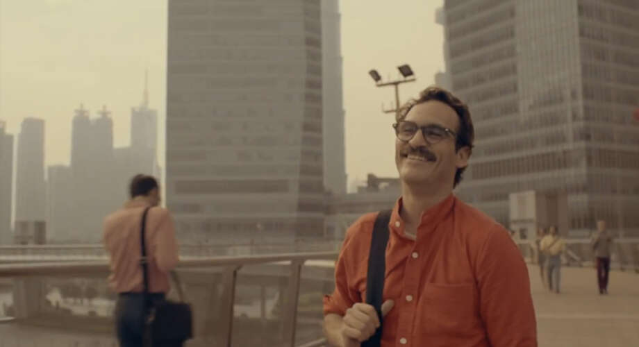 4. HER: Spike Jonze writes and directs this oddball futuristic love story between a man and his software with a surprising amount of compassion and empathy. Photo: Warner Bros. Pictures