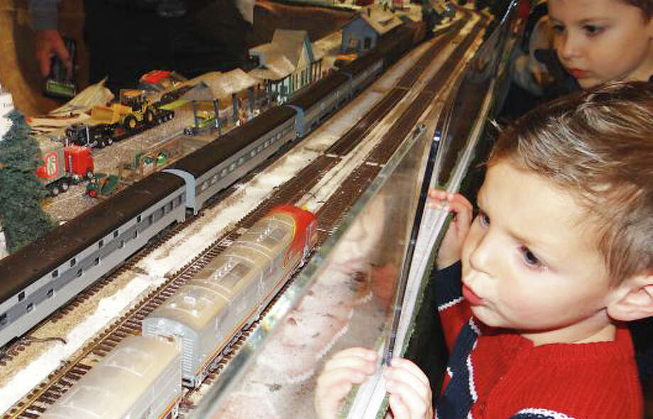 The Holiday Express Train Show continues its run through the holidays at the Fairfield Museum and History Center, before pulling out of town Jan. 5. It's sure to delight train buffs of all ages, as in this scene from last year's show. Photo: File Photo / Fairfield Citizen