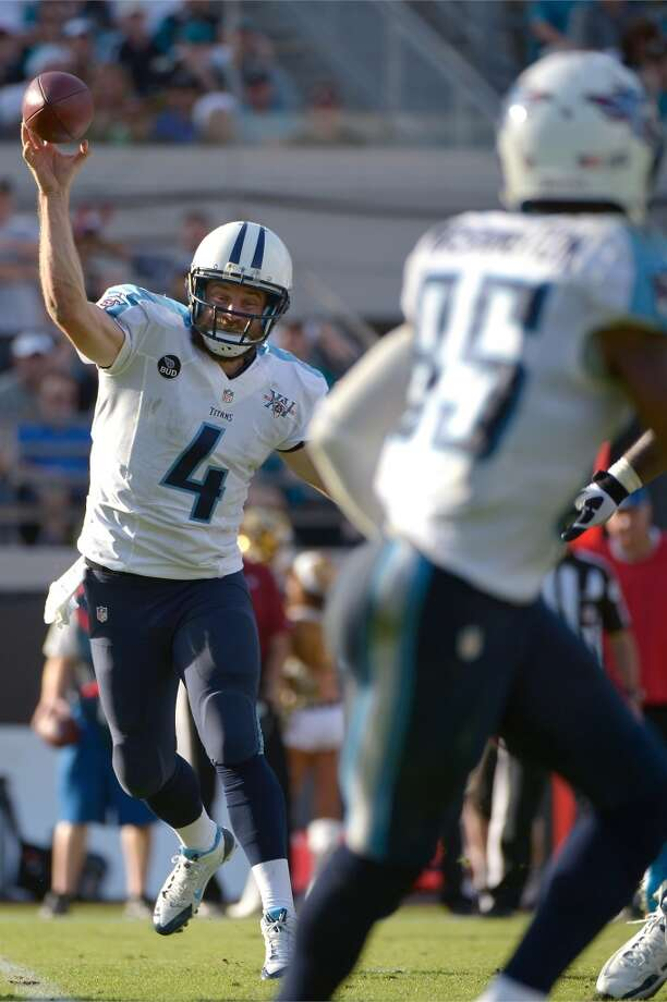Houston (2-13) plus-7 at Tennessee (6-9): Titans 23-13 Photo: Phelan M. Ebenhack, Associated Press