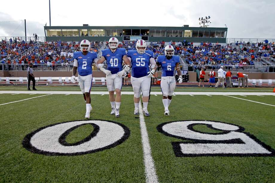 25. HBU begins football   The scoreboard read: Sam Houston 74, Houston Baptist 0. The score, of course, did not matter. Because it was the first time in its 53-year history, Houston Baptist played a football game. Photo: Thomas B. Shea, For The Chronicle