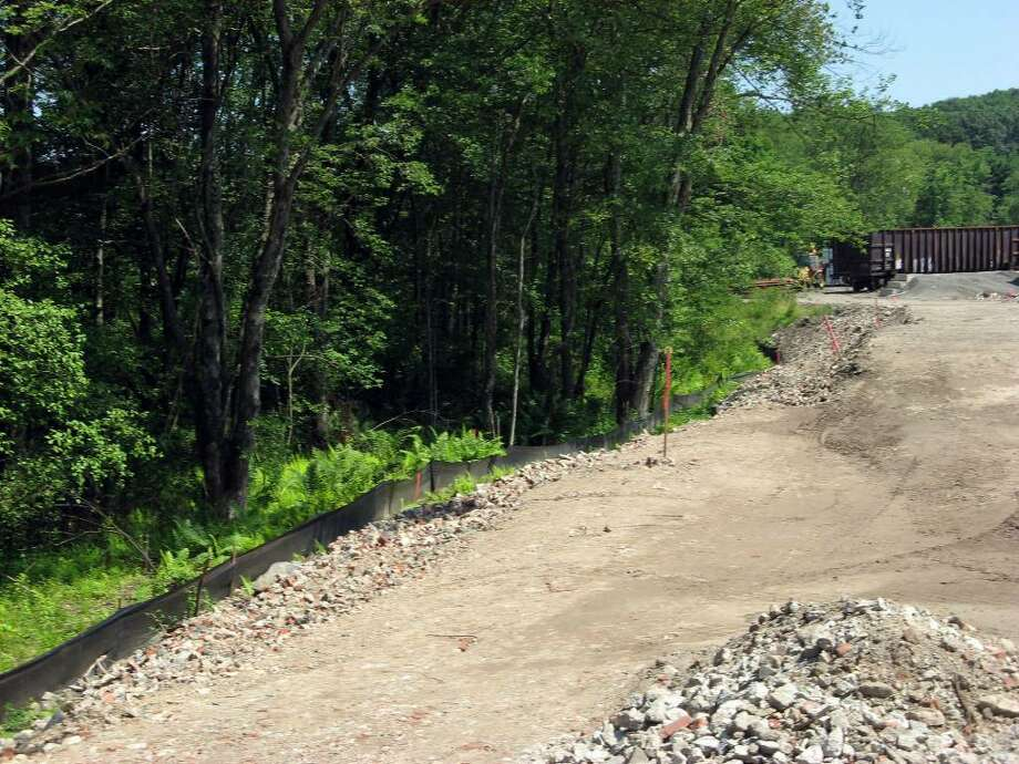 A black plastic barrier acts as a boundary to separate fill from the edge of wetland bodies on the Housatonic Railroad's property in Hawleyville. Photo: Contributed Photo / The News-Times Contributed