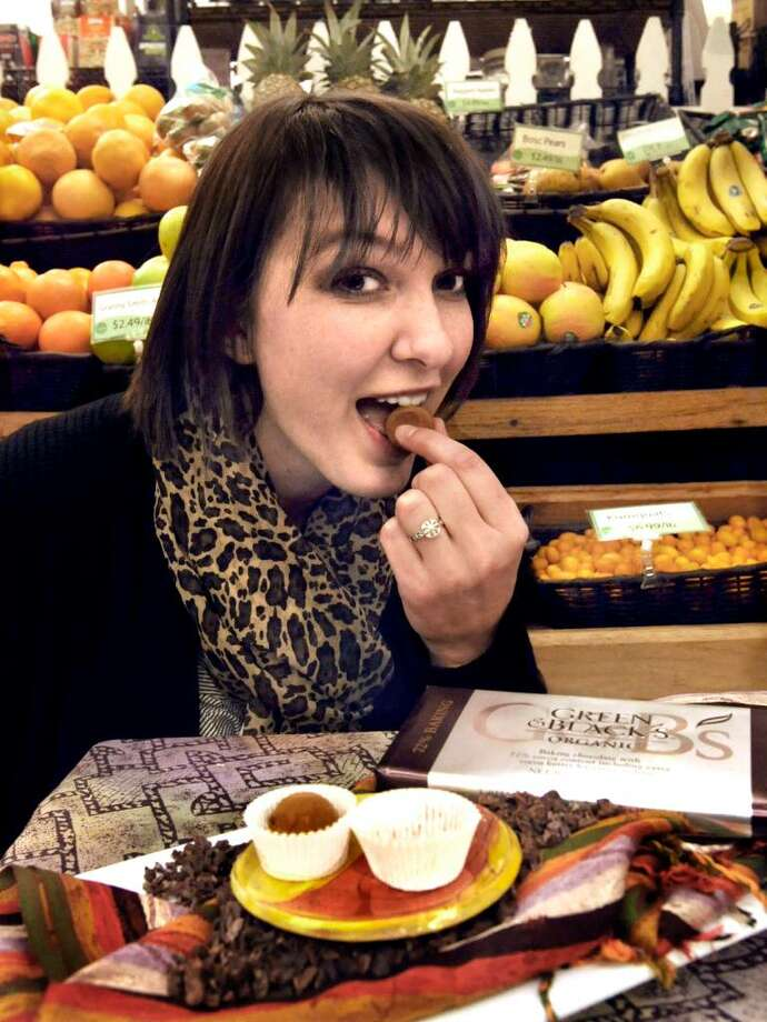 Julie Benedetto, of Woodbury, bites into a vegan truffle, on Wendesday, Jan.27,2010. Photo: Michael Duffy / The News-Times