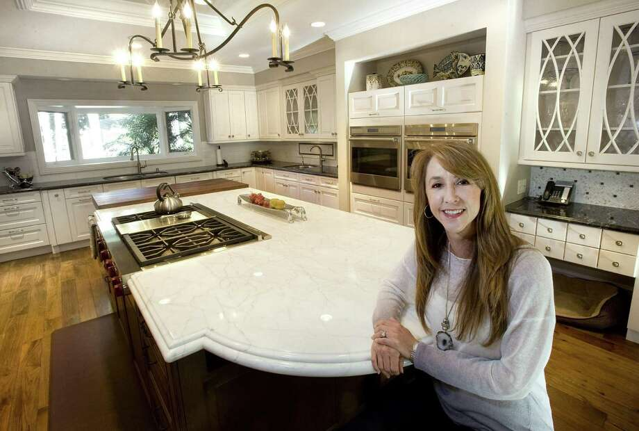 Michelle Christy's recently remodeled kitchen in North Tustin, Calif., features a large island, new appliances and three sinks. Photo: H. Lorren Au Jr. / Orange County Register / Orange County Register