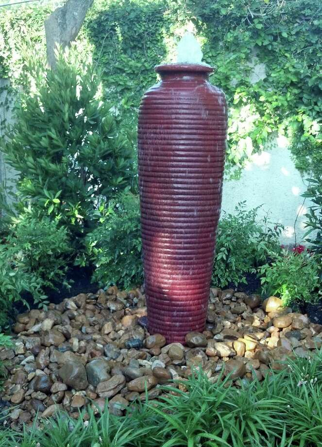 Water burbling in a tall urn was the finishing touch for Sharon Loy's backyard. Photo: Courtesy Preferred Landscape And Lighting