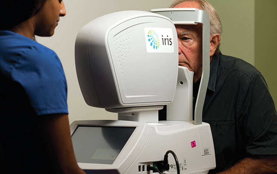 A patient at Harris Health System's Martin Luther King Jr. Health Center is screened with a new technology that detects diabetic retinopathy, the most common eye disease among diabetic patients. Photo: Courtesy Of Harris Health System / Jack Thompson 2013