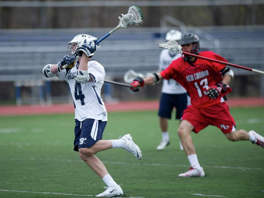 Staples' Colin Bannon takes a shot during Saturday's lacrosse game against New Canaan in Westport, Conn., on April 20, 2013. Photo: Lindsay Perry / Stamford Advocate