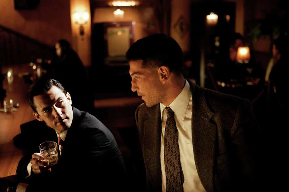"This photo provided by TNT shows Milo Ventimiglia, left, and Jon Bernthal in a scene from the TNT drama series, ""Mob City."" Here's a sassy, two-fisted show inspired by love: creator Frank Darabont's love for the grand film-noir tradition, which he honors impeccably in this crime drama set in 1940s L.A. (AP Photo/TNT, Scott Garfield) ORG XMIT: NYET122 Photo: Scott Garfield / TNT"