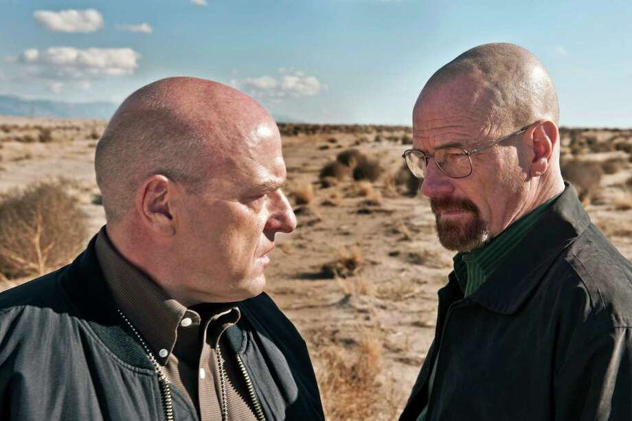 "This publicity image released by AMC shows Dean Norris as Hank Schrader, left, and Bryan Cranston as Walter White in ""Breaking Bad.""  The series is returning for its eight final episodes starting Sunday at 9 p.m. EDT. The long-awaited showdown places Hank in direct conflict with the villainous hero, Walter White. (AP Photo/AMC, Frank Ockenfels) ORG XMIT: NYET930 Photo: Frank Ockenfels / AMC"