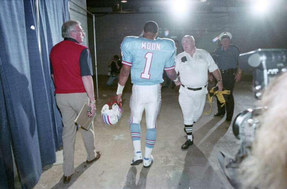 The 1993 Oilers season - one of the craziest in NFL history - ended with a stunning home playoff loss to Joe Montana and the Chiefs. Quarterback Warren Moon, center, heads to the locker room for the last time as an Oiler.