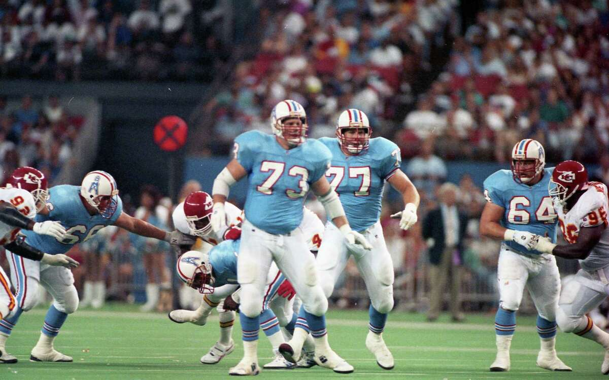 Oilers Doug Dawson (66), David Williams (73), Kevin Donnally (77) and Erik Norgard (64) during a game against the Kansas City Chiefs in September 1993.