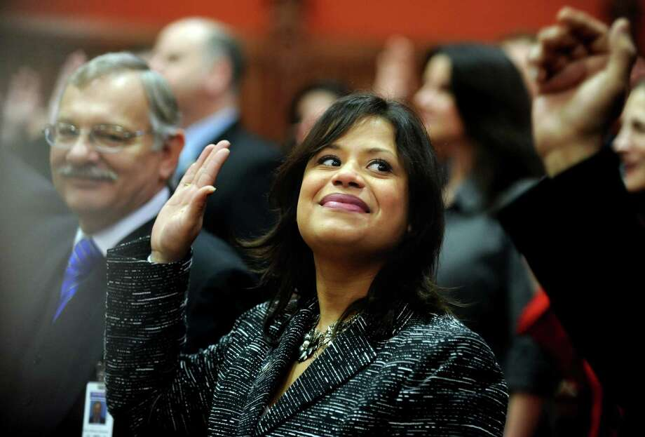 State Rep. Christina Ayala, D-128, is sworn in Wednesday, Jan. 9, 2013 during opening day of the State Legislature at the Capitol Building in Hartford, Conn. Photo: Autumn Driscoll / Connecticut Post