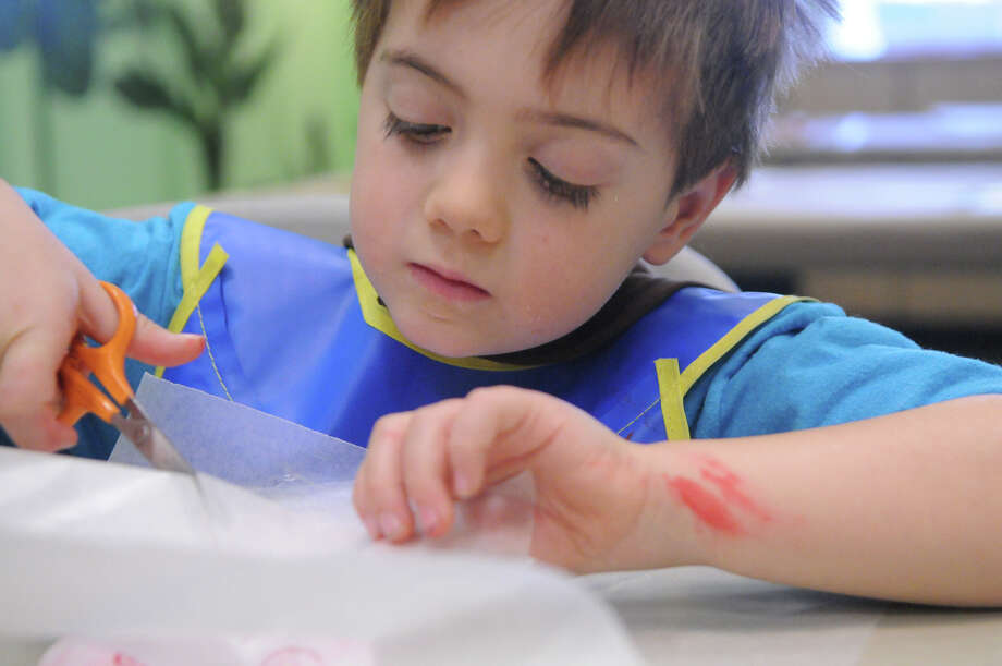 Sam Battistini, 6, at work as he and other yung artists learn about printmaking with a hands-on workshop at the Bruce Museum in Greenwich, Conn., Dec. 27, 2013. Photo: Keelin Daly, Contributed / Stamford Advocate Freelance