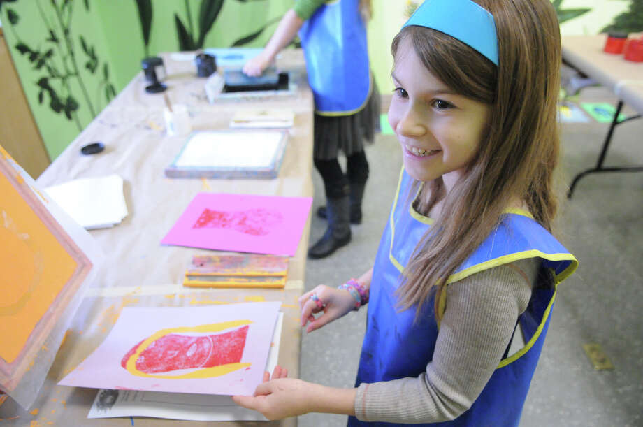 Denislava Krasteva Gale, 8, examines her print as she and other young artists learn about printmaking with a hands-on workshop at the Bruce Museum in Greenwich, Conn., Dec. 27, 2013. Photo: Contributed / Stamford Advocate Freelance