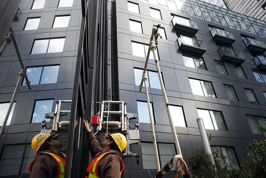 Francisco Marin works on the north tower of the Nema apartment complex on San Francisco's booming Mid-Market. Photo: Lacy Atkins, The Chronicle