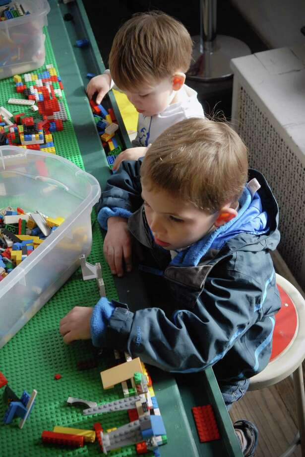 Nolan (2) and Noah (5) Jurczak play with Legos after viewing A Billion Bricks: Lego T-Rex, Turtles and Trains exhibit at the Stamford ( Conn.) Museum and Nature Center on December 27, 2013. Photo: Dru Nadler / Stamford Advocate Freelance