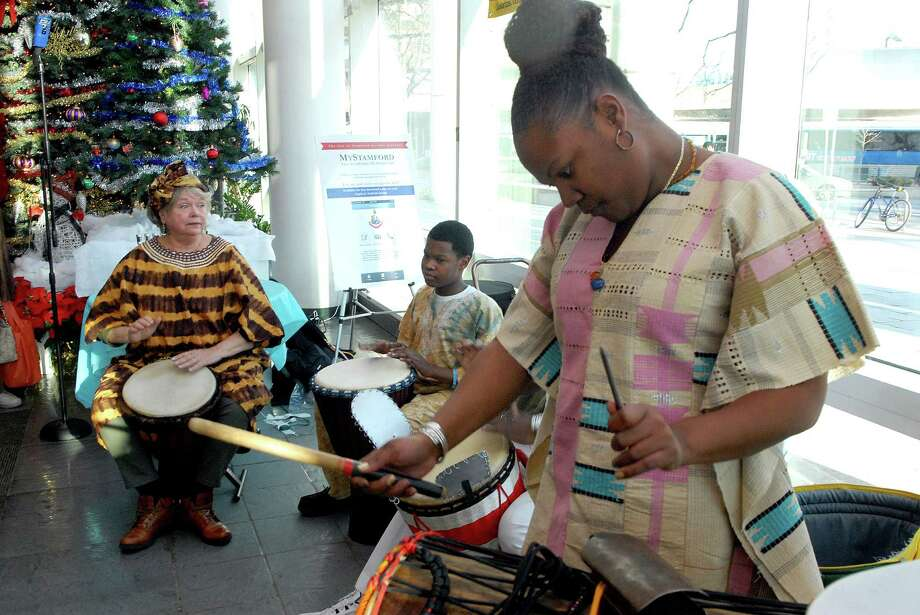 Judith Rochon, Cristian Colvin and Monica Tinsley play at the 19th annual Mayor's Kwanzaa Celebration in the Stamford Government Center on Friday  December 27, 2013. Photo: Dru Nadler / Stamford Advocate Freelance