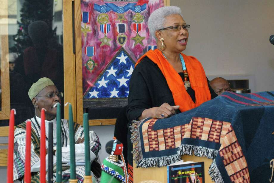 Josephine Fulcher Anderson explains the seven principals of Kwanzaa at the 19th annual Mayor's Kwanzaa Celebration in the Stamford Government Center on Friday  December 27, 2013. Photo: Dru Nadler / Stamford Advocate Freelance