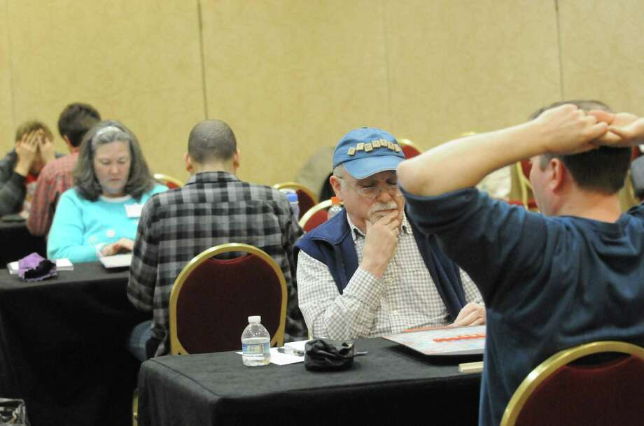 Word enthusiasts face-off during the Annual Nor'easter Scrabble Tournament  Friday Dec. 27, 2013, at the Marriott Hotel in Colonie, N.Y. (Michael P. Farrell/Times Union) Photo: Michael P. Farrell / 00024883A