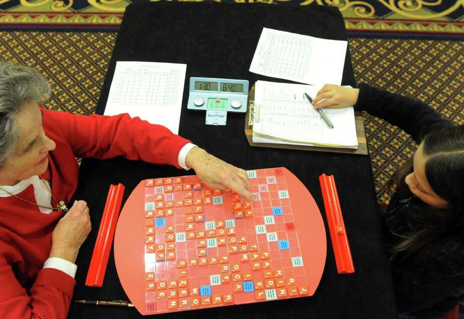 Eleven-year-old Chloe Fatsis, right, of Wasington,D.C. plays Jane Marsh of Albany in Scrabble during the Annual Nor'easter Scrabble Tournament at the Marriott Hotel on Friday Dec. 27, 2013 in Colonie, N.Y. (Michael P. Farrell/Times Union) Photo: Michael P. Farrell / 00024883A