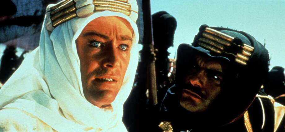 "Peter O'Toole, 1932-2013: His most famous role was the lead in ""Lawrence of Arabia"" (shown here with Omar Sharif) but the Irish-born actor, played many other memorable roles throughout his long career — from Henry II in ""The Lion in Winter,"" to the namesake role in ""Goodbye, Mr. Chips"" to restaurant critic Anton Ego in Pixar's ""Ratatouille."" He died Dec. 14 at age 81. Photo: Michael Ochs Archives, File Photos / 2013 Getty Images"