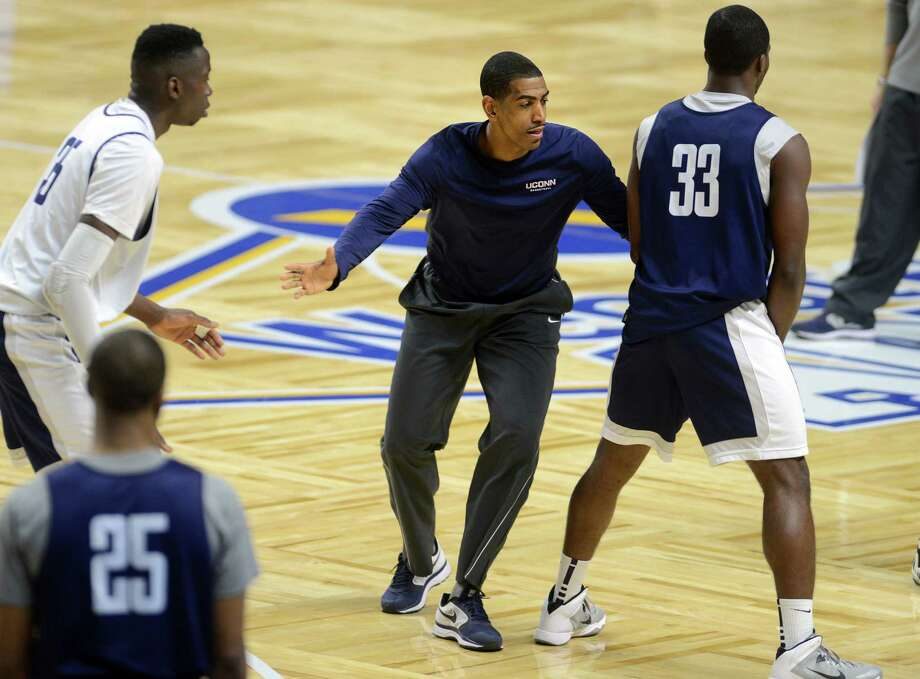 Kevin Ollie coaches the UConn men's basketball team during practice Friday, Dec. 27, 2013 at the Webster Bank Arena in Bridgeport, Conn. Photo: Autumn Driscoll / Connecticut Post