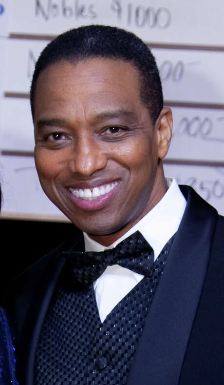 Khambrel Marshall now wears bow ties to work, not just at formal occasions like the Junior League's Starry Night Gala in February 2012. Photo: Michael Martinez