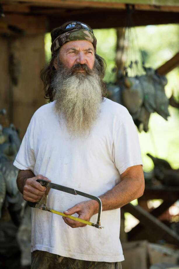 """A&E shows Phil Robertson from the popular series """"Duck Dynasty,"""" was suspended for disparaging comments he made to GQ magazine about gay people. There is debate about whether he made an actual apology but in part he said, """"I centered my life around sex, drugs and rock and roll until I hit  rock bottom and accepted Jesus as my Savior. My mission today is to go  forth and tell people about why I follow Christ and also what the bible  teaches, and part of that teaching is that women and men are meant to be  together. However, I would never treat anyone with disrespect just  because they are different from me...."""" Photo: Zach Dilgard, HOEP / A&E"""