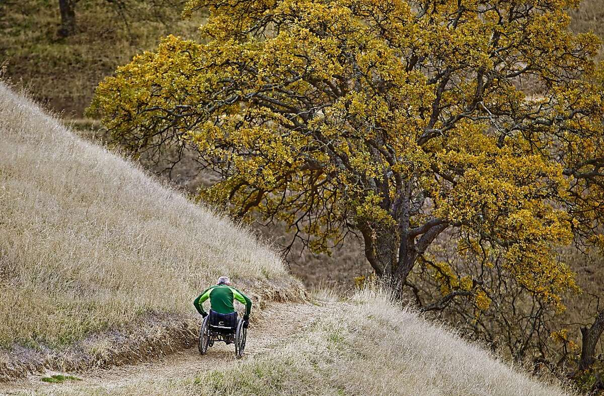 Wheelchair hiker Bob Coomber climbs a single track trail in Holdener Park in Livermore, Ca. , on Thursday Dec. 19, 2013. Bob Coomber doesn't let his disability hold him back as he hikes the many trails and mountains of Northern California in his wheelchair.