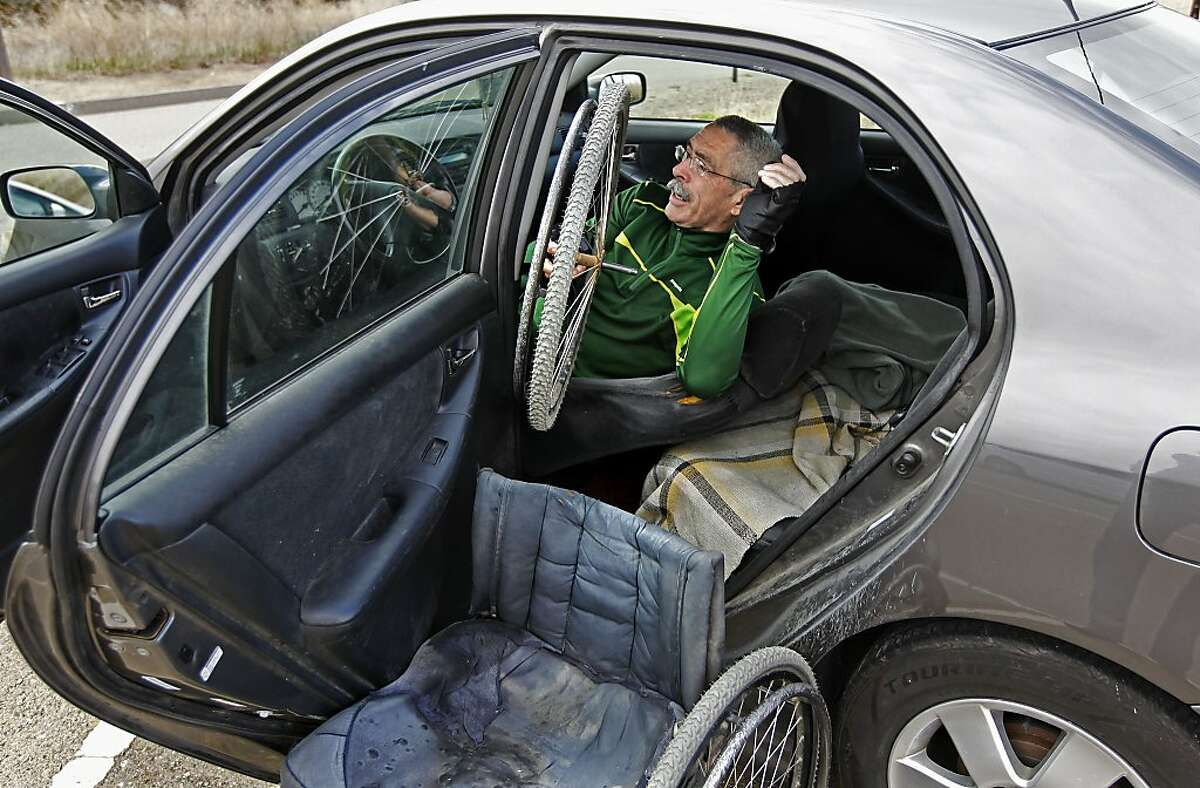 Wheelchair hiker Bob Coomber breaks down his wheelchair and loads it back into his car after a hike in Holdener Park in Livermore, Ca. , on Thursday Dec. 19, 2013. Bob Coomber doesn't let his disability hold him back as he hikes the many trails and mountains of Northern California in his wheelchair.