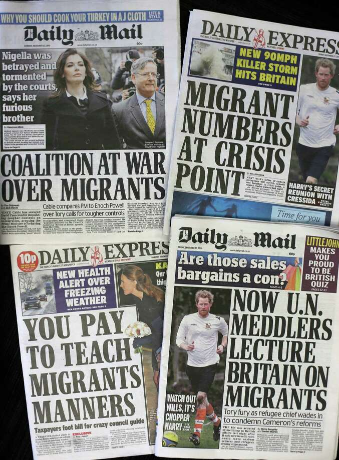 Recent editions of Britain's Daily Express and Daily Mail newspapers, featuring headlines about immigration, are photographed in London, Friday, Dec. 27, 2013. For months, Britain's tabloids have repeatedly warned of the horrors they believe will ensue after Jan. 1, 2014 when work restrictions will be lifted across the European Union for migrants from Romania and Bulgaria — two of the trading bloc's newest members. Those changes, the papers claim, will unleash a mass exodus of the poor and unemployed from the two eastern European countries to Britain. (AP Photo/Alastair Grant) Photo: Alastair Grant, STF / AP