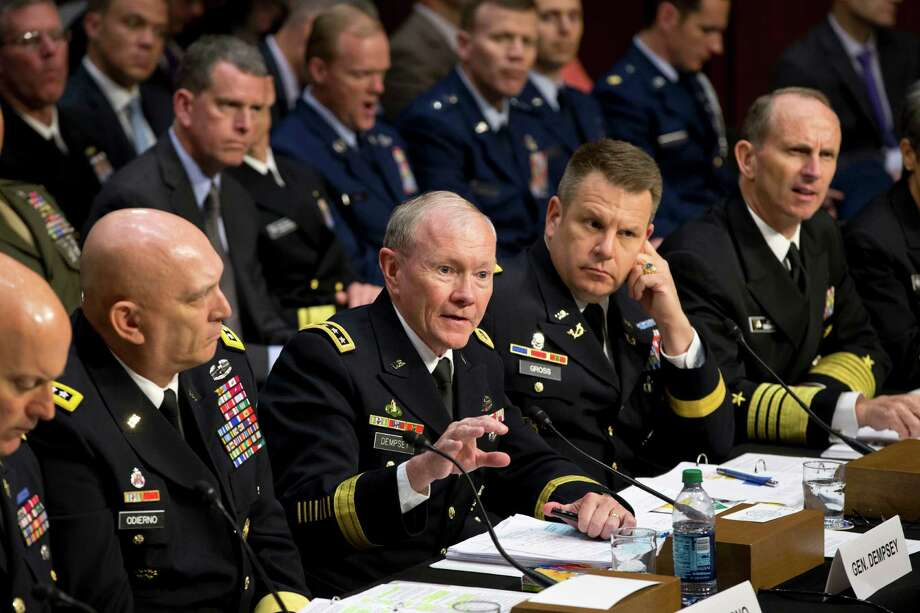 FILE - In this June 4, 2013 file photo, Joint Chiefs Chairman Gen. Martin Dempsey, center, testifies on Capitol Hill in Washington, before the Senate Armed Services Committee hearing investigating the growing epidemic of sexual assaults within the military. The number of reported sexual assaults across the military shot up by more than 50 percent this year. Defense officials suggest that victims are becoming more willing to come forward. The increase follows a tumultuous year of scandals that shined a spotlight on the crimes and put pressure on the military to act aggressively. From left are, Judge Advocate General of the Army Lt. Gen. Dana K. Chipman, Army Chief of Staff Gen. Ray Odierno, Legal Counsel to the Chairman of the Joint Chiefs of Staff Brig. Gen. Richard C. Gross, and Chief of Naval Operations Adm. Jonathan W. Greenert.(AP Photo/J. Scott Applewhite) Photo: J. Scott Applewhite, STF / AP