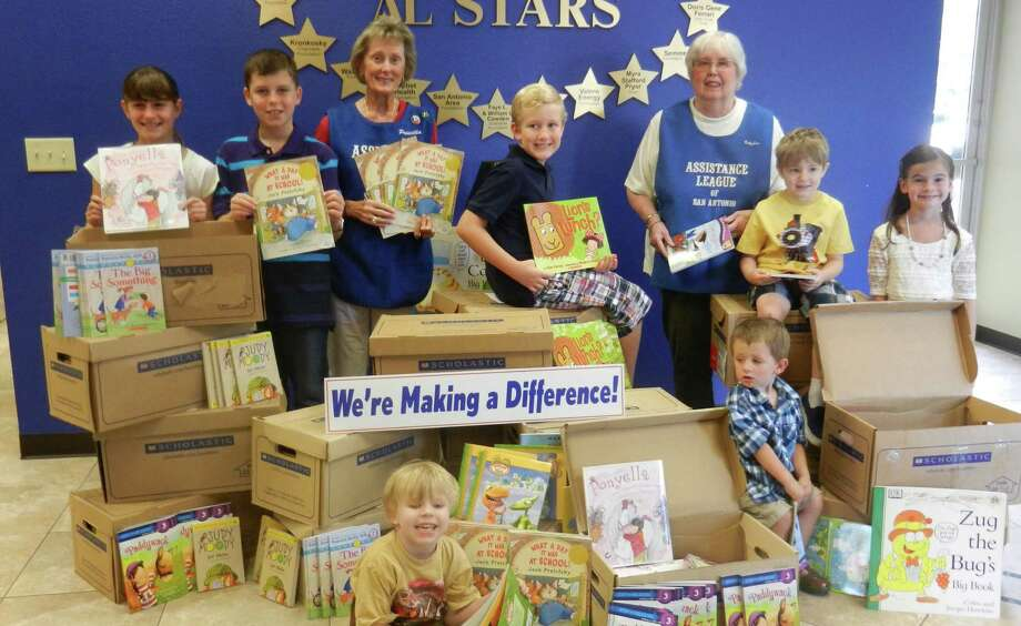 Priscilla Allen, left, president of the Assistance League of San Antonio and league member Betty Sue Hayes are surrounded by some of the more than 14,400 books the organization donated in 2013 to help San Antonio children. Photo: Courtesy