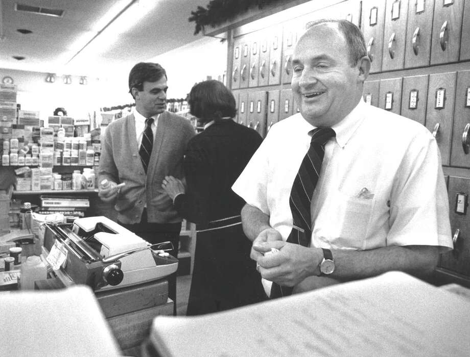 Pharmacist Frank Wright in his Cos Cob drugstore on Jan. 29, 1988. The store was preparing to be open on New Year's Day. Photo: File Photo, Greenwich Time / Greenwich Time