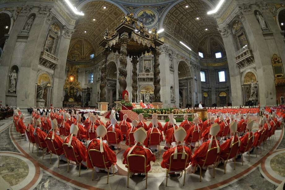 Cardinals attend a Mass at St. Peter's Basilica before the start of the conclave on March 12. Cardinals moved into the Vatican that day as suspense built ahead of a secret papal election with no clear front-runner to steer the Catholic world through troubled waters after Pope Benedict XVI's historic resignation. Photo: Gabriel Bouys / Getty Images / AFP