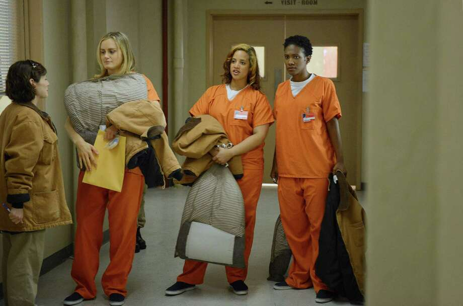 """Yael Stone, from left, Taylor Schilling, Dascha Polanco and Vicky Jeudy star in  Netflix's """"Orange Is the New Black."""" Photo: Ursula Coyote, Handout / ONLINE_YES"""