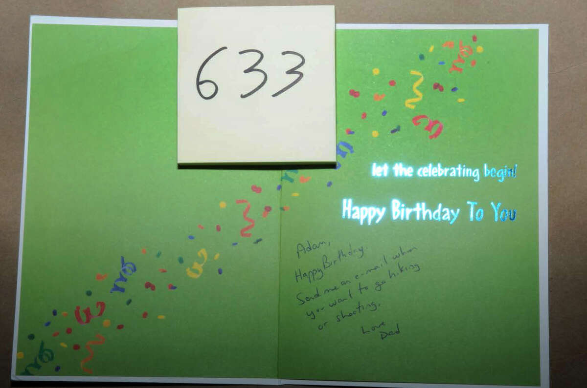 Photograph of a birthday card from Peter Lanza to his son Adam found in the Lanza home on Yogananda Street in Newtown, Conn. The full Sandy Hook Elementary School shooting reports were released by the Connecticut State Police on Friday, Dec. 27, 2013.
