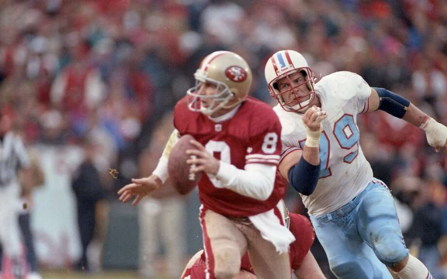 Oilers Ray Childress (79) zeroes in on 49ers quarterback Photo: John Makely, Houston Chronicle