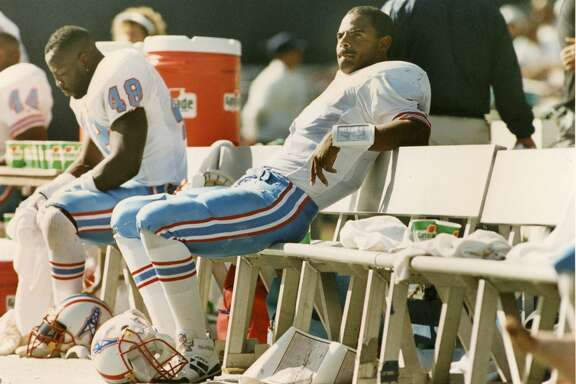 Oilers quarterback Warren Moon sits on the bench during the fourth quarter at Jack Murphy Stadium. The Oilers lost to the Chargers, 18-17.
