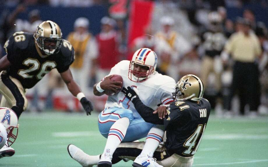 Oilers quarterback Warren Moon (1) is sacked Photo: Dave Einsel, Houston Chronicle
