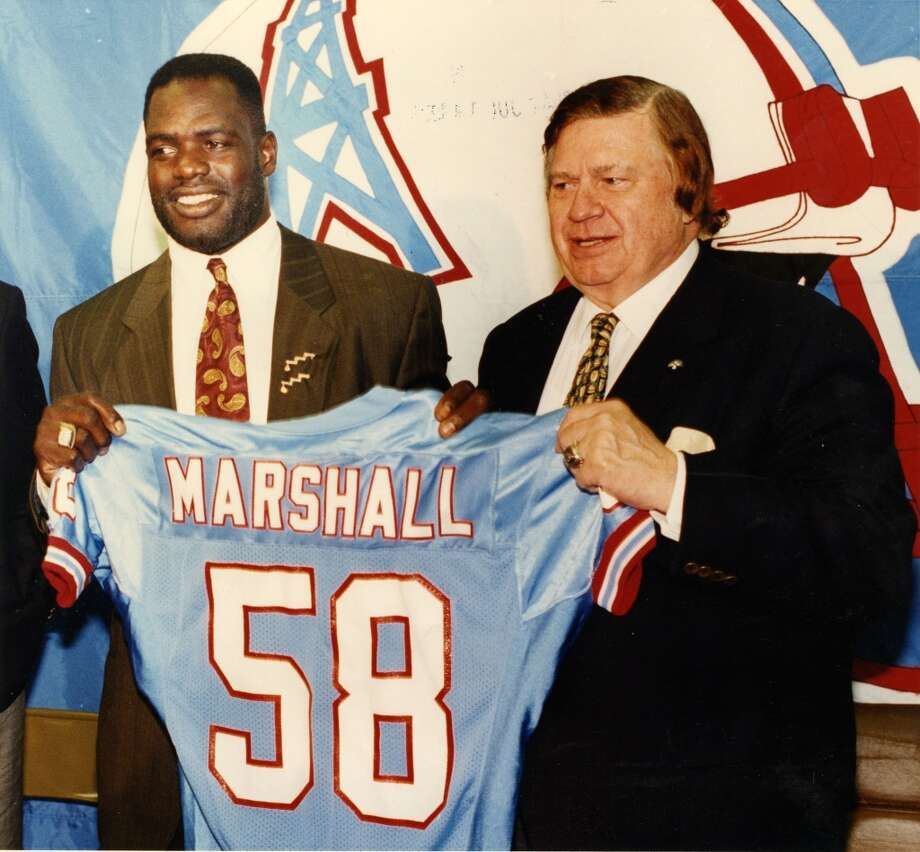 "New Oilers linebacker Wilber Marshall, left, is introduced by Oilers owner Kenneth ""Bud"" Adams. Photo: Jerry Click, Houston Chronicle"