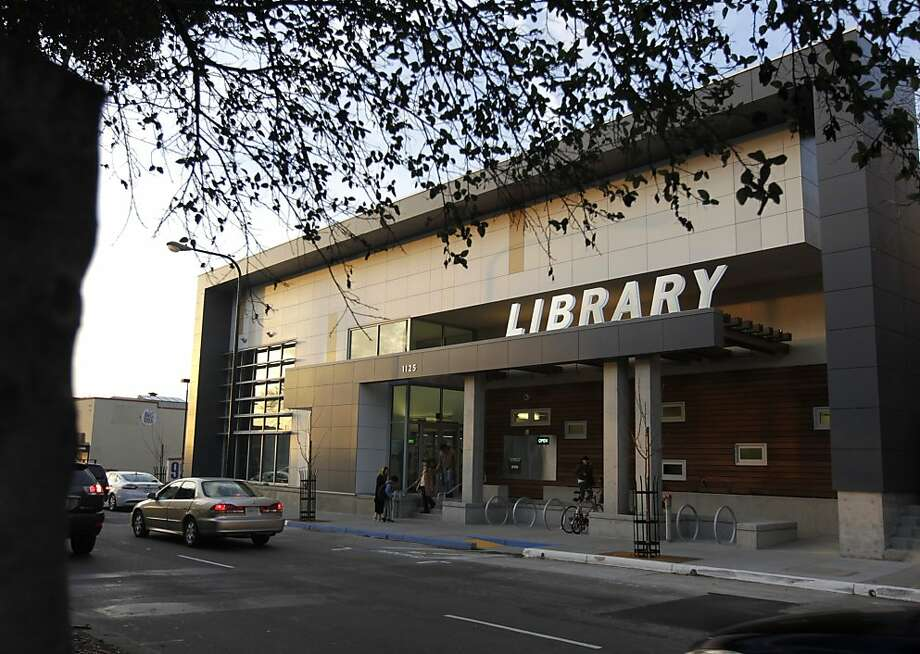 The new West Berkeley branch library, above, is a zero net energy building, which generates as much electricity as it needs during a year through the use of such features as solar panels and rain screens. Photo: Paul Chinn, The Chronicle
