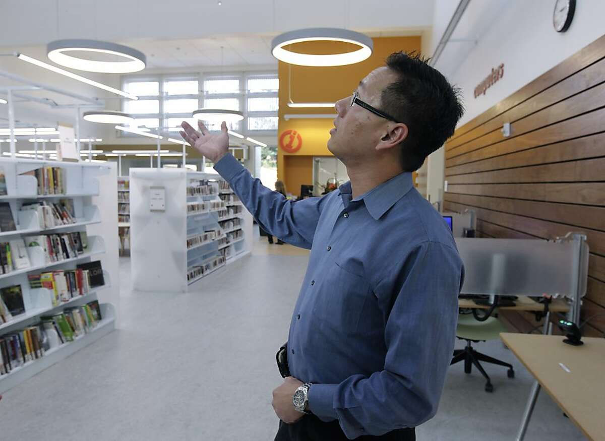 """Architect Gerard Lee points out the energy-efficient features incorporated in the new West Berkeley Library branch in Berkeley, Calif. on Tuesday, Dec. 17, 2013. The recently reopened branch is designated as """"net-zero"""" which means it generates as much electricity as it uses during the year."""