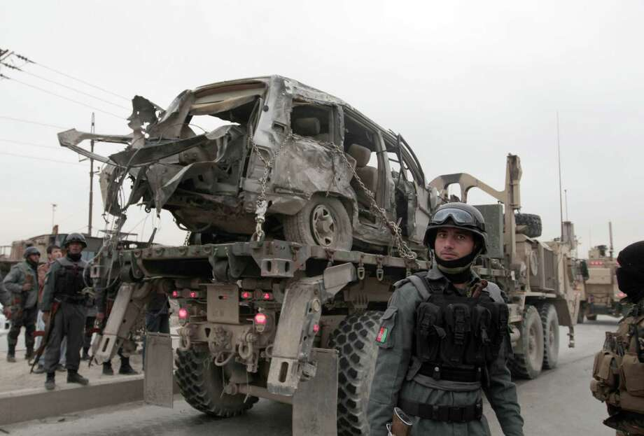 A car bomb targeting a military convoy killed three coalition soldiers Friday in Kabul, Afghanistan. Photo: Rahmat Gul, STR / AP
