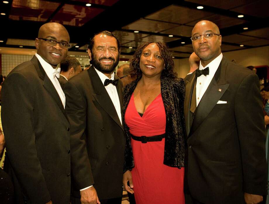 In this file photo, Laolu Davies-Yemitan, left, co-chaired a 2008 Houston Citizens Chamber of Commerce event also attended by U.S. Rep. Al Green, co-chair Dannette Davis and now-HCC trustee Carroll Robinson, right. HCC is investigating whether Robinson tried to get Davies-Yemitan hired by a college contractor. Photo: James Nielsen, Staff / Houston Chronicle