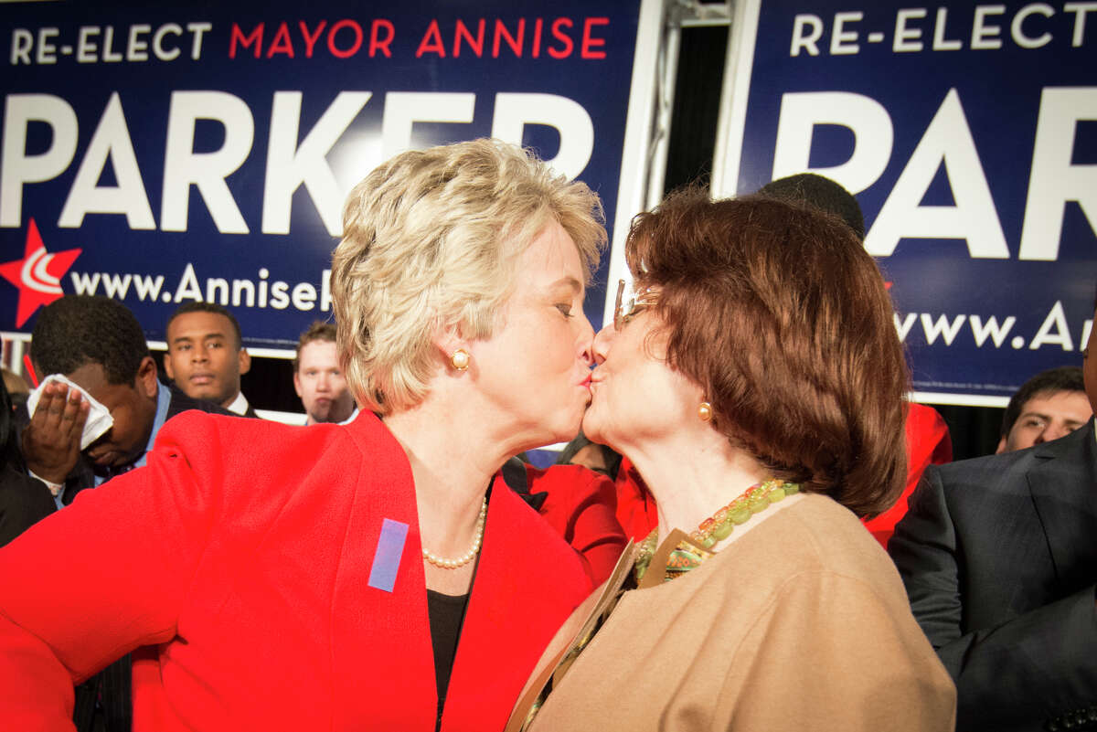 Mayor Annise Parker, left, kisses her partner Kathy Hubbard at an election victory party in November.