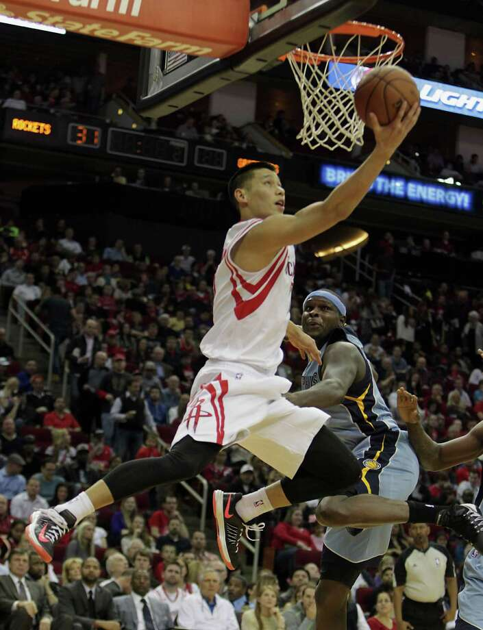 Above, point guard Jeremy Lin left, cranked up the energy to spark the Rockets' fourth-quarter resurgence against the Grizzlies on Thursday. Photo: James Nielsen, Staff / © 2013  Houston Chronicle