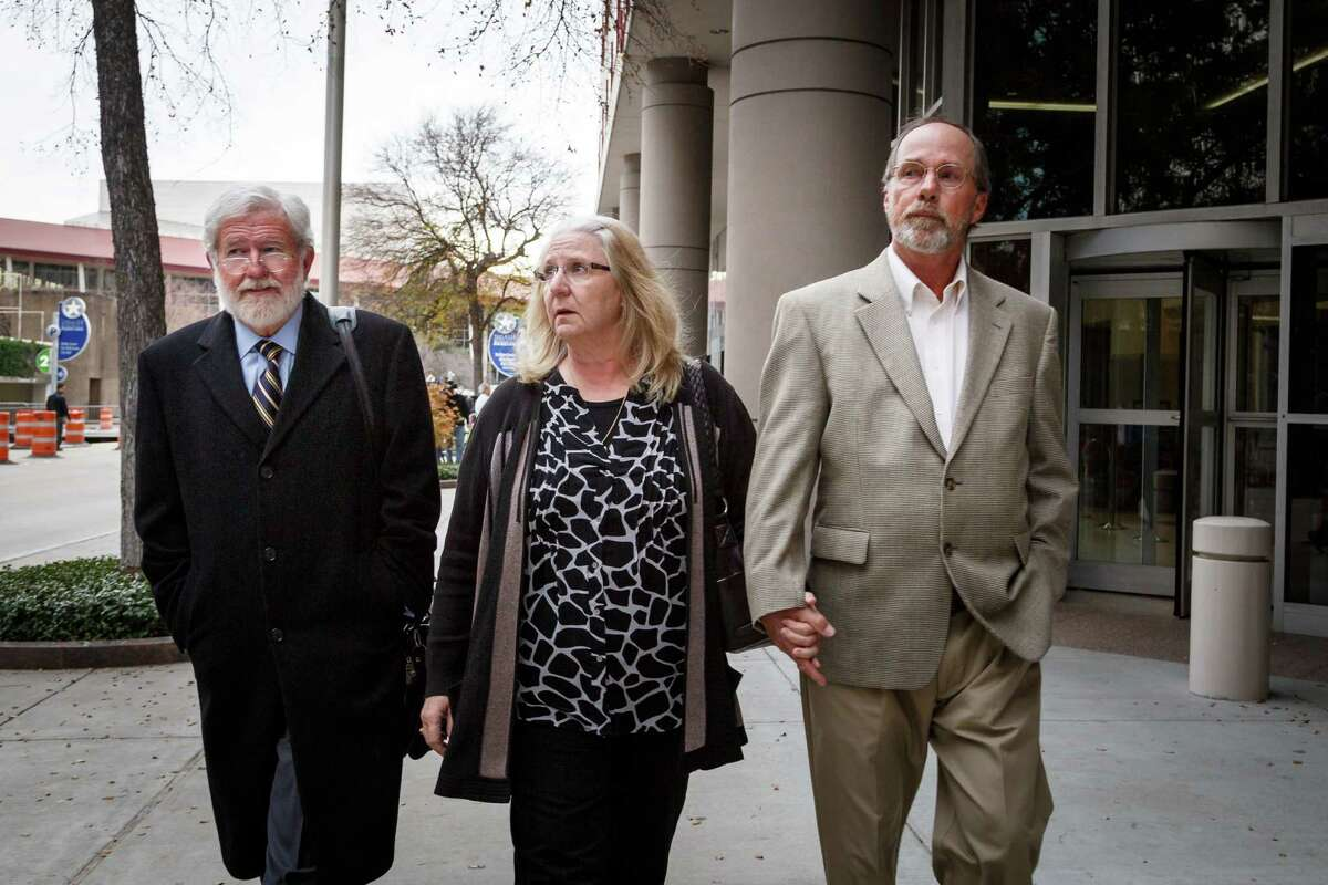Attorney George Parnham, left, with Barrett's parents in December 2013.